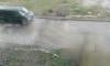 На Северном проспекте прорвало трубу: кипяток затопил парковку