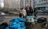 Жители Мурино выловили мусор из городского болота