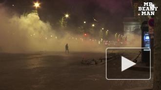 Полиция применила слезоточивый газ на Елисейских полях против болельщиков