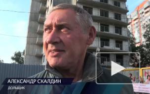 """Дольщики недостроя в Коломягах обвинили компанию """"Окстрой"""" в воровстве"""