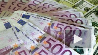 Официальный курс евро и доллара на выходные вновь вырос